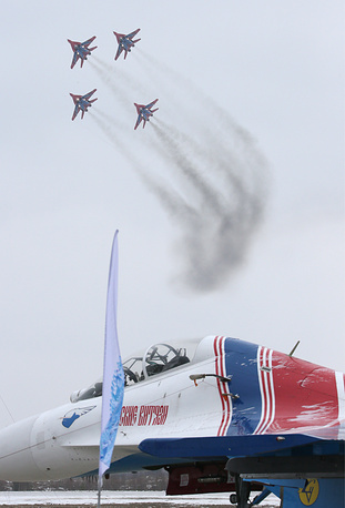 Russian aerobatic team Strizhi performs during Paralympic torch relay near Moscow