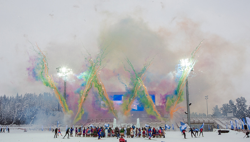 Performers in folk costumes take part in a welcome ceremony of the Paralympic torch relay in Khanty-Mansiysk