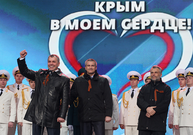 Crimea's Prime Minister Sergey Aksyonov (center), Speaker of the Crimean Parliament (left) Vladimir Konstantinov and head of Sevastopol Aleksei Chalyi during a rally on Red Square in Moscow
