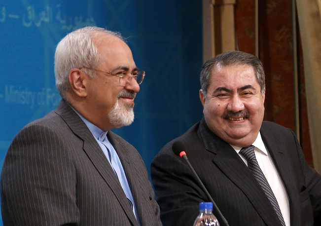 Iraqi Foreign Minister Hoshyar Zebari (right) with his Iranian counterpart Mohammad Javed Zarif