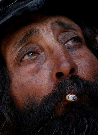 Romani system of values has taken centuries to develop and today affects the lives and moral of modern Romani. Photo: a man smokes in a Romani village in Romania, 2003