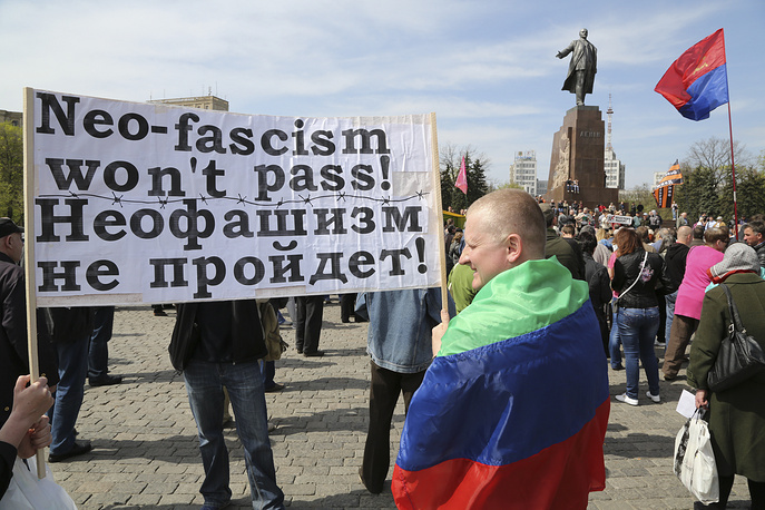 Pro-Russian protesters attend a rally in downtown Kharkiv