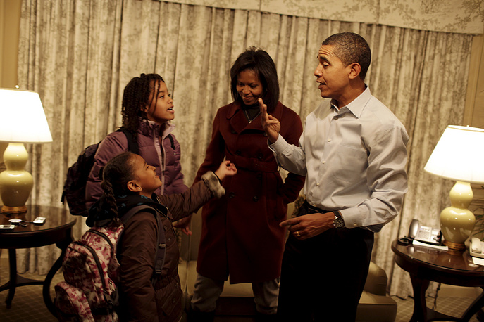 Barack and Michelle Obama as they get their daughters Sasha (L) and Malia (2nd L) ready for their first day of school