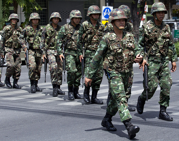 Thai soldiers patrol near the Army Club before former Prime Minister Yingluck Shinawatra arrives to report to Thailand's ruling military