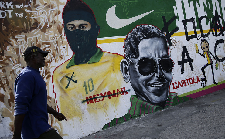 A mural featuring Brazil's Neymar which has been modified to make the striker look like a protester against the World Cup