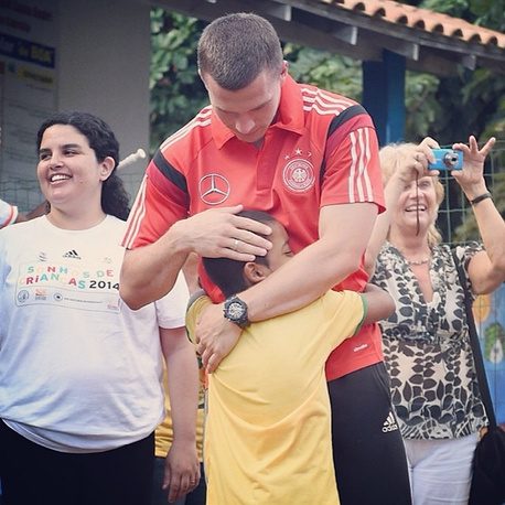 Germany's Lukas Podolski got a warm welcome at one of the schools near the base of his national team