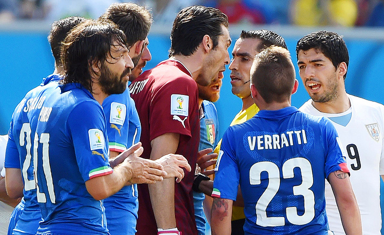 Italy's goalkeeper Gianluigi Buffon (C) argues with Mexican referee Marco Rodriguez
