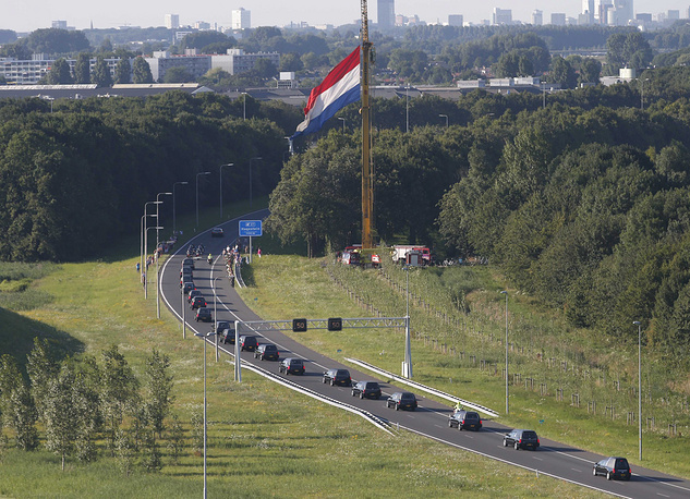 The column of funeral hearses drive from the airbase in Eindhoven