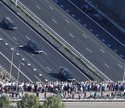 Mourners line the route of the hearses
