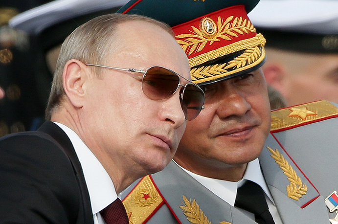 Russia's President Vladimir Putin (L) and Defence Minister Sergei Shoigu during the Navy Day parade in Severomorsk