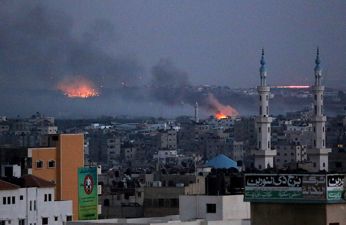 Smoke rises after Israeli shelling in Al Shejaeiya neighbourhood during a military operation in the east of Gaza City