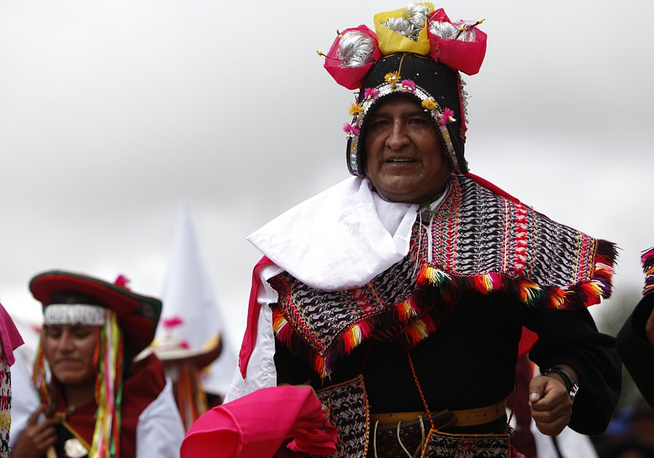 Bolivia's President Evo Morales wears traditional Bolivian clothes at a dance festival in 2011