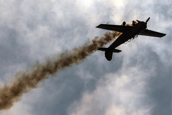 A Yak-54 training aircraft of the First Flight aerobatics team performs during the Forsazh (Boost) car and air show