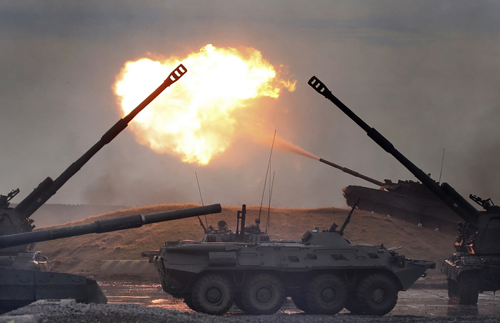 A Russian infantry combat vehicle and a tank take part in the demonstration program