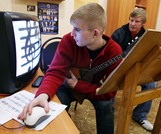Photo: A student at the boarding school of music for the blind, Kursk, Russia, 2009