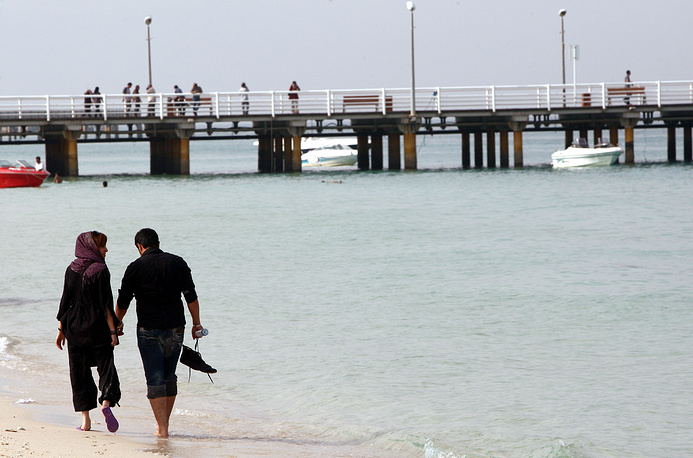 Kish island is Iranian special economic zone. It's a consumer's paradise, with numerous malls, shopping centres, tourist attractions, and resort hotels. Photo: An Iranian couple enjoy a walk in a beach on Kish Island southern Iran, 26 April 2011