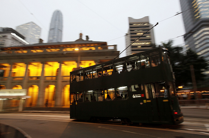 Iconic double-deck tram drives in the Central, the business district of Hong Kong