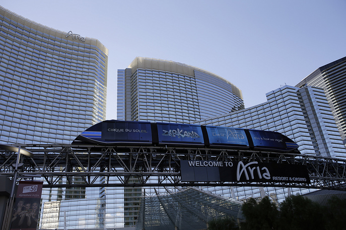 Photo: futuristic-looking tram travels by the front of the Aria Resort & Casino in Las Vegas, USA