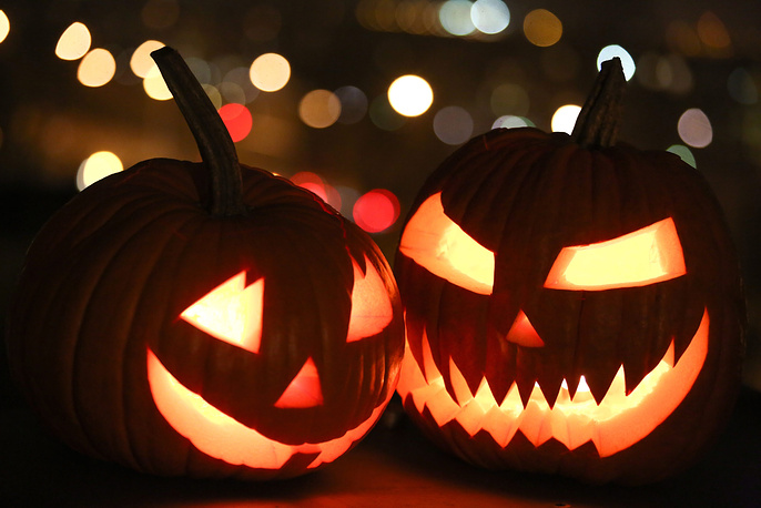 Photo: Two pumpkin Jack-o-lanterns are on display in Warsaw, Poland, 30 October, one day before Halloween