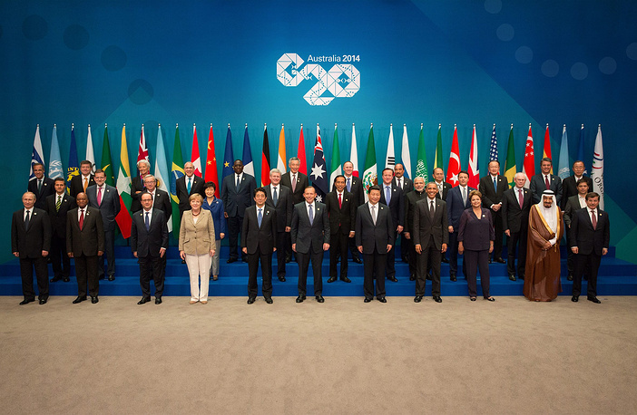 The Group of Twenty, or G20, is a leading international forum specializing in global economy and finances. It consists of the world's largest advanced and emerging economies, which represent some two-thirds of the world's population, 85% of global gross domestic product and more than 75% of global trade. Photo: Leaders from the G20 Summit pose for the family photo at their meeting in Brisbane, Australia 15 November 2014