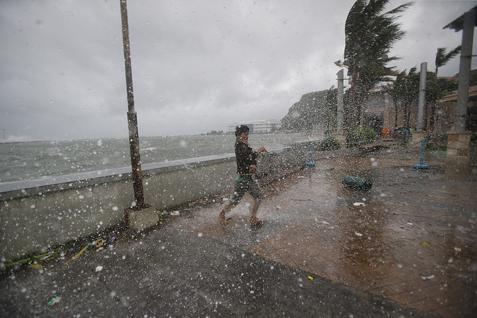 "Hagupit means ""lash"" in Filipino. Photo: Strong winds and rain from Typhoon Hagupit hit shore in Legazpi, eastern Philippines, December 7, 2014"