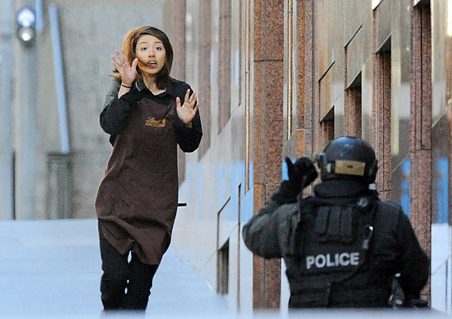 Local media report that five people have managed to escape the Lindt cafe in Australia's Sydney. Photo: A female employee hostage at the cafe managed to escape from the Lindt cafe in Sydney