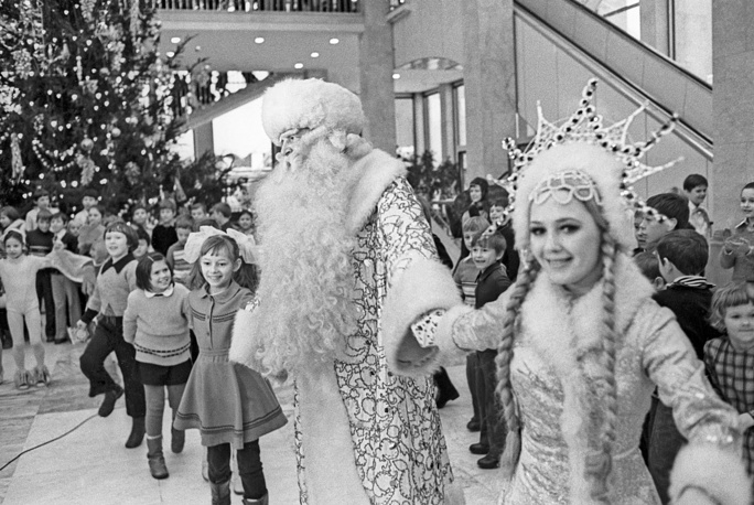 Father Frost (Russian Santa Clause) and Snegurochka (Snow maiden) entertain children in the Kremlin Palace of Congresses, 1977