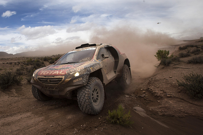 Peugeot driver Stephane Peterhansel and co-pilot Jean Paul Cottret, both of France, race during the 7th stage of the Dakar Rally 2015