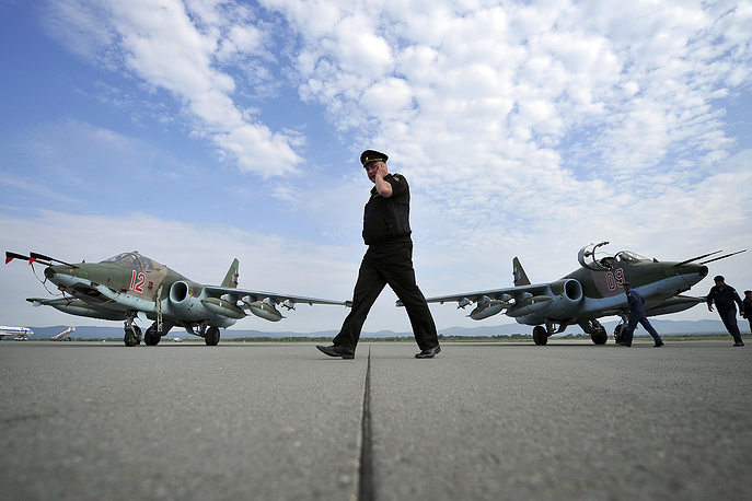 Su-25SM fighter jets and crew members from Russia's Eastern Military District air force unit at the Knevichi aerodrome