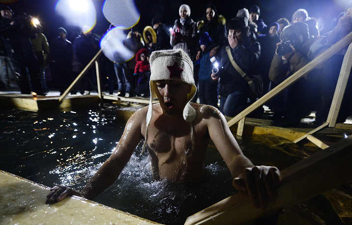 Russian Orthodox believers take a dip in the icy waters of Amur Bay, Vladivostok