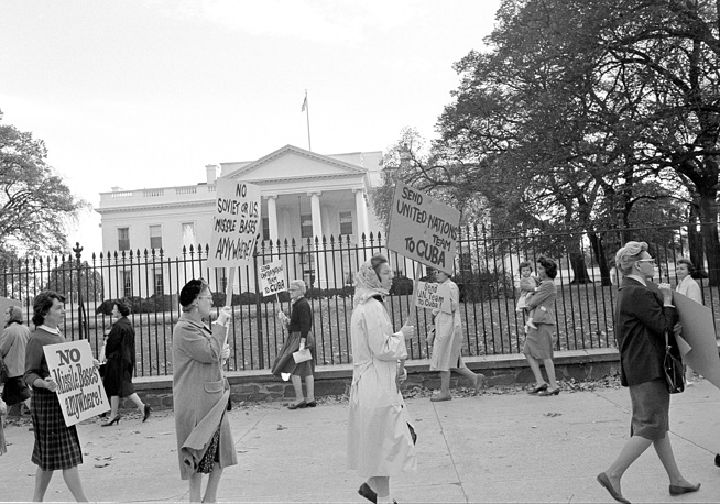 Cuban Missile Crisis, a 13-day confrontation between the United States and the Soviet Union over Soviet ballistic missiles deployed in Cuba occurred in 1962. Photo: Women protesting the Cuban Missile Crisis demonstrate in front of the White House in Washington, USA October 23, 1962