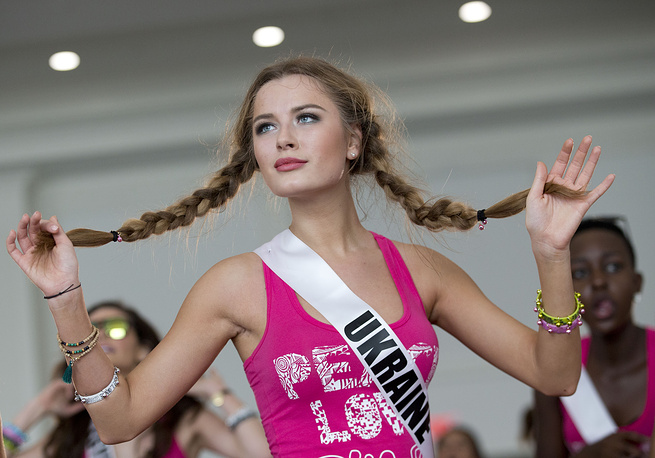 Miss Universe contestant Diana Harkusha, of Ukraine, participates in a Zumba class for the contestants