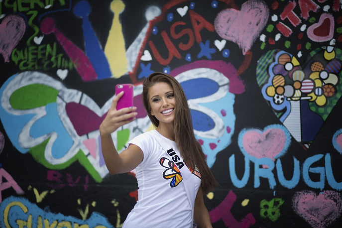Miss USA, Nia Sanchez after painting on a wall in Miami's Wynwood area