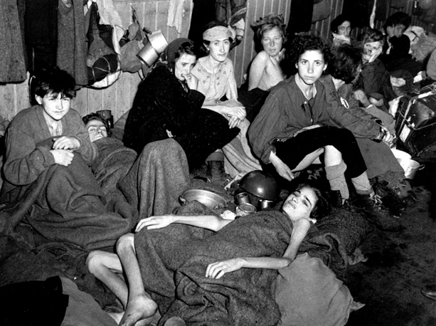 Women and children, some of over 40,000 concentration camp inmates liberated by the British in a barrack at Bergen-Belsen, Germany, 1945