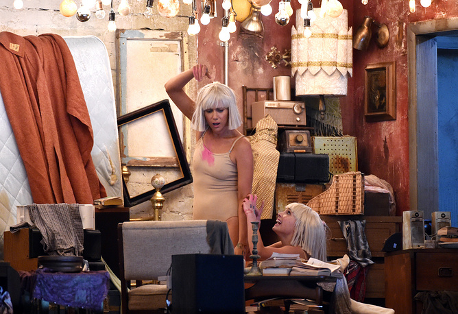 "Kristen Wiig and Maddie Ziegler performing as Sia sings ""Chandelier"" at the 57th Grammy Awards"