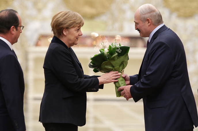German Chancellor Angela Merkel receives flowers from Belarus President Alexander Lukashenko