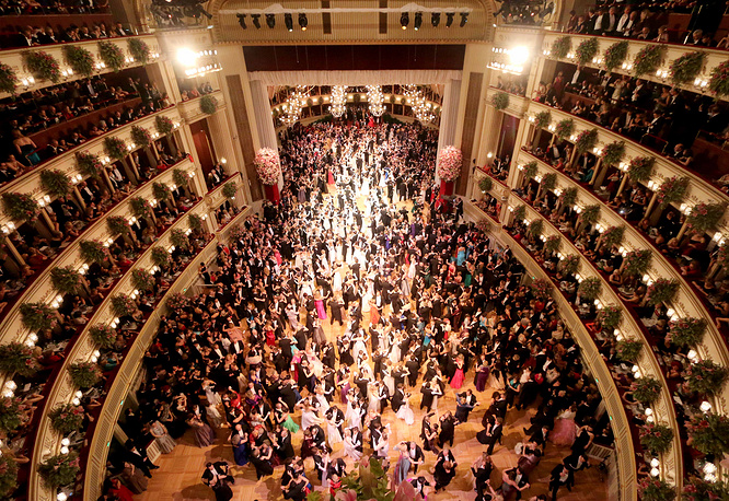 The event takes place in the building of the Vienna State Opera. Photo: Dancers crowd the dance floor during traditional Opera Ball in Vienna