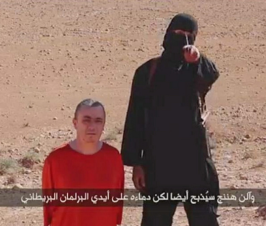 British hostage Alan Henning was beheaded by an Islamic State militant somewhere in a desert setting in October 2014