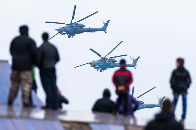 Mi-28N helicopters of the Berkuty (Golden Eagles) aerobatic team flying during an air show