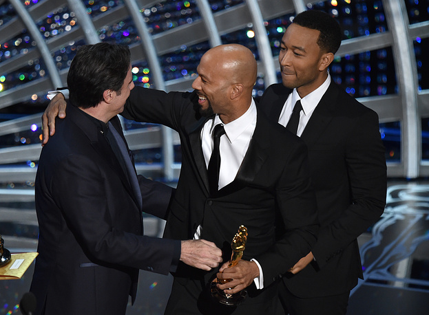 """Glory"" from ""Selma"" won the award for best original song. Photo: John Travolta presenting Common and John Legend with the award"