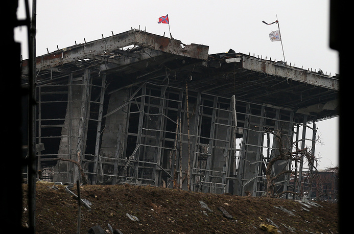 The spokesman of self-proclaimed Donetsk People's Republic said that the fire from grenade launchers emerged from the territory under control of the Ukrainian military and the fact was registered by all sides present during the incident. Photo: A ruined terminal of the Donetsk airport