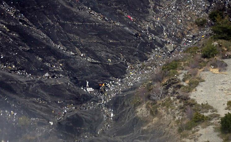 About a dozen of gendarmes were helicoptered to the area and winched down into the ravine where thousands of debris are scattered on mountainsides. Photo: Wreckage and debris on the mountain slopes after the crash of the Germanwings Airbus A320 over the French Alps, France