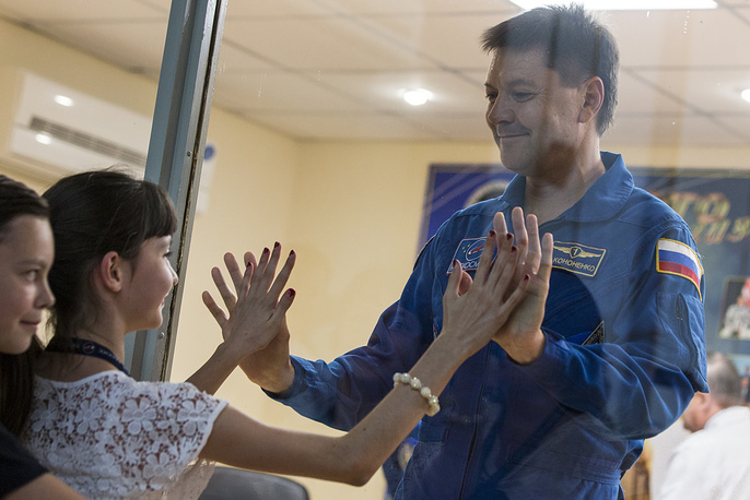 Russian cosmonaut Oleg Kononenko with his daughter Alice as his son Andrew