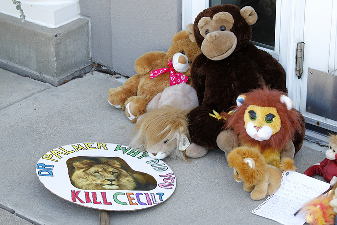 Stuffed animals and notes outside Dr. Walter James Palmer's dental office in Bloomington, USA