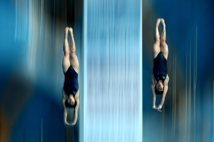 North Korea's Kim Un Hyang and Song Nam Hyang competing in the Women's Synchronised Diving 10m Platform event, July 27