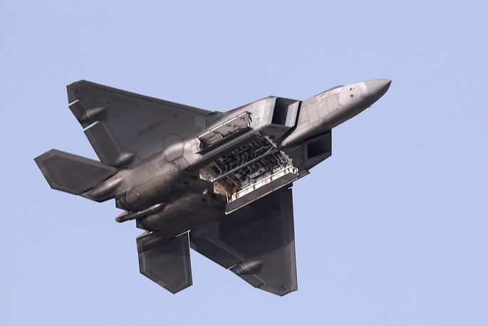 Lockheed Martin F-22 Raptor all-weather stealth tactical fighter aircraft performing a demonstration flight