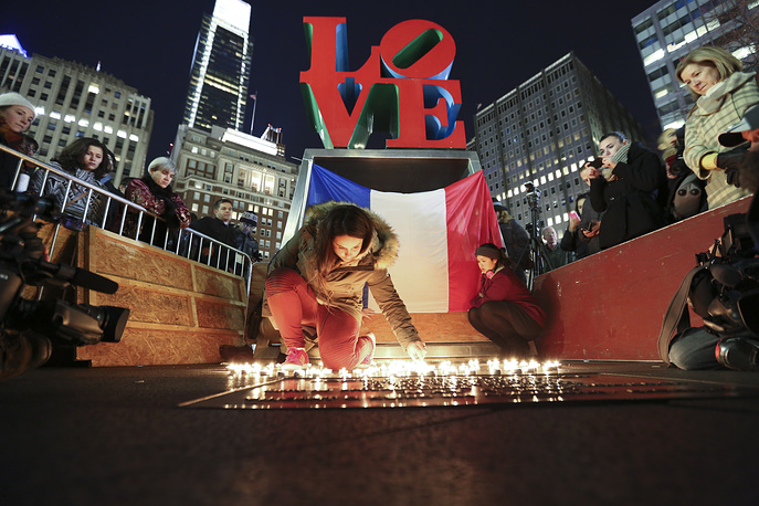 Candlelight vigil to remember the victims of the attacks in Paris in LOVE Park, Philadelphia United States