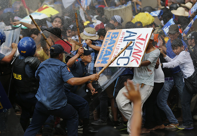 Police firing water cannons at student activists as they clash near the venue hosting the APEC summit in Manila