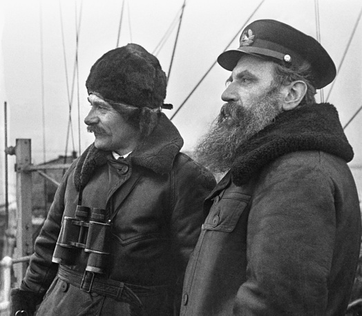 Captain of the Ermak icebreaker Vladimir Voronin and leader of an expedition Otto Schmidt during their trip to the North Pole, 1938