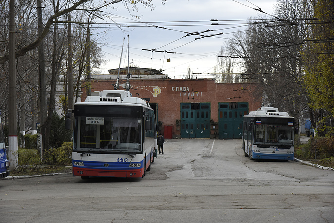 Unpowered trolley buses seen at their park after a power failure, in Simferopol
